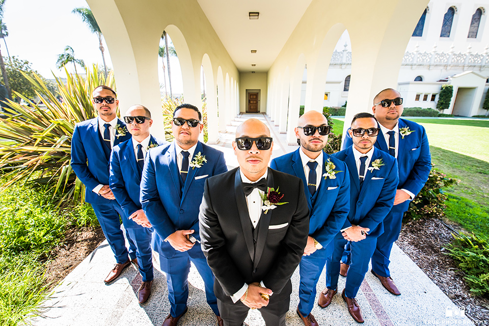 San-Diego-Wedding-groomsmen-in-cobalt-suits-and-the-groom-is-in-a-black-tuxedo-with-a-black-bow-tie