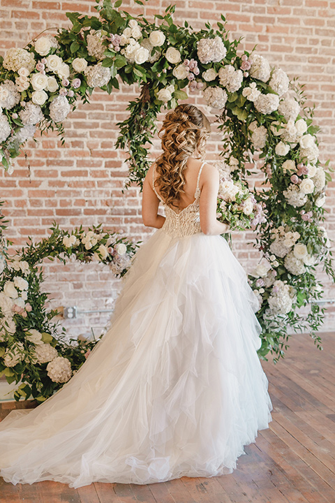 bride in a tulle white gown with a low back detail and a sweetheart neckline