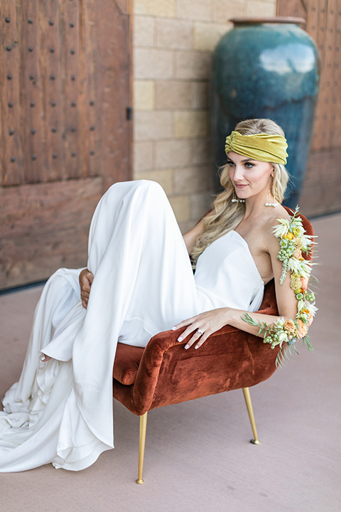 fazeli-winery-wedding-bride-in-chair-in-a-sheath-white-gown-and-velvet-headpiece