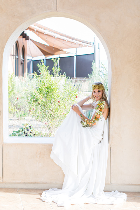 fazeli-winery-wedding-bride-in-window-with-a-boho-dress-and-velvet-accessories