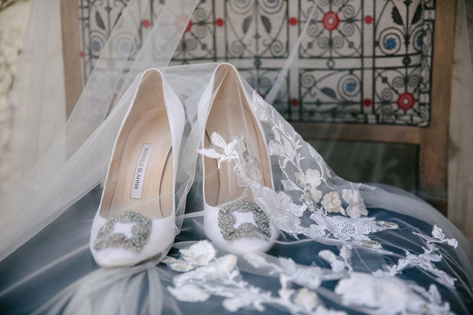 White bridal shoes with a silver buckle detail