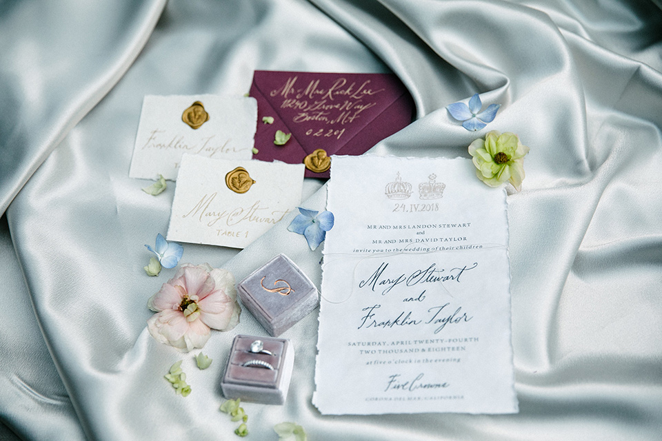 white and floral embellished invitations