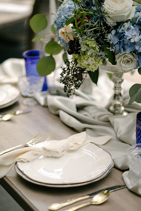 white linens with white and silver flatware