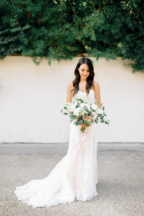 franciscan-gardens-wedding-bride-alone-in-a-mermaid-white-strapless-gown-with-hair-down-in-a-simple-wave