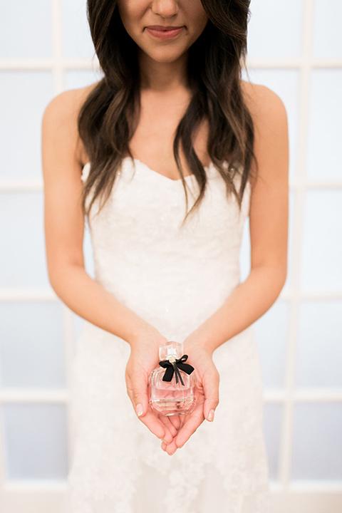 franciscan-gardens-wedding-bride-holding-perfume