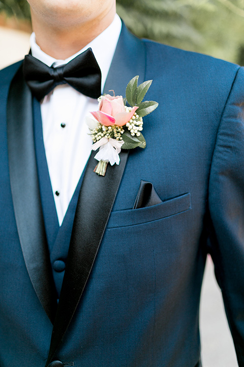 franciscan-gardens-wedding-close-up-on-groom-look-groom-in-a-dark-blue-tuxedo-with-a-black-shawl-lapel-and-black-bow-tie