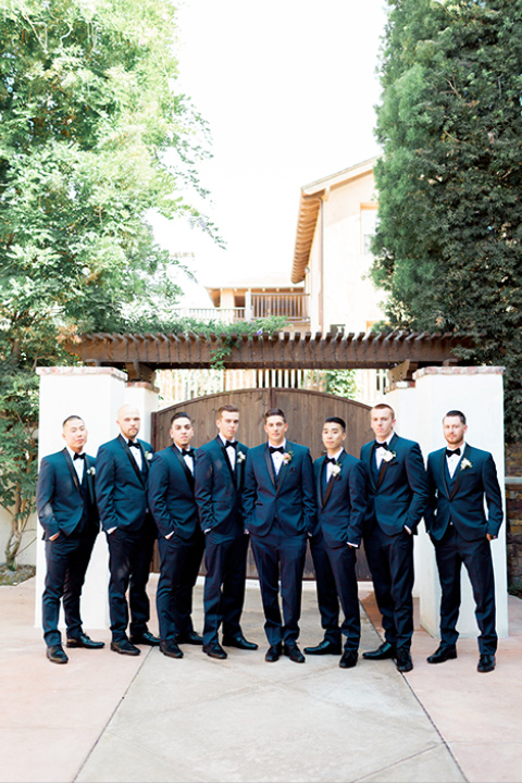 franciscan-gardens-wedding-groomsmen-and-groom-in-a-navy-shawl-lapel-tuxedo-with-black-accessories