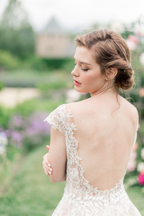 bride in a champagne gown with a low cut back with a lace trim detail