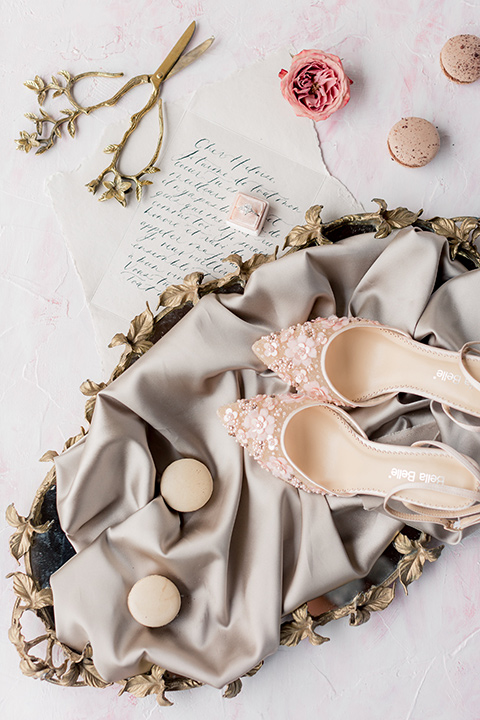 blush colored shoes with rings and pink florals