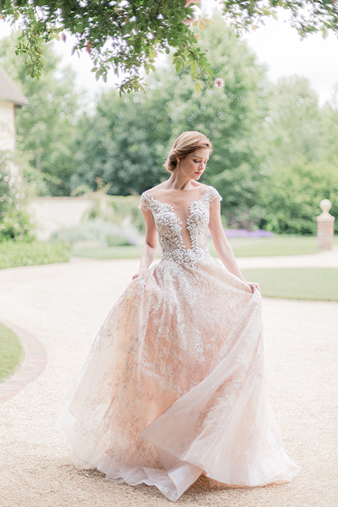 bride in a champagne ballgown with a cap sleeve and lace detailing