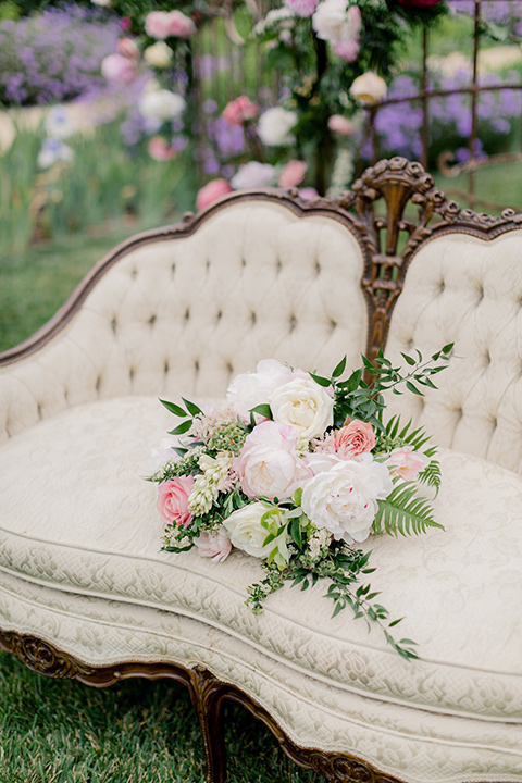 white and pink florals on a white vintage couch