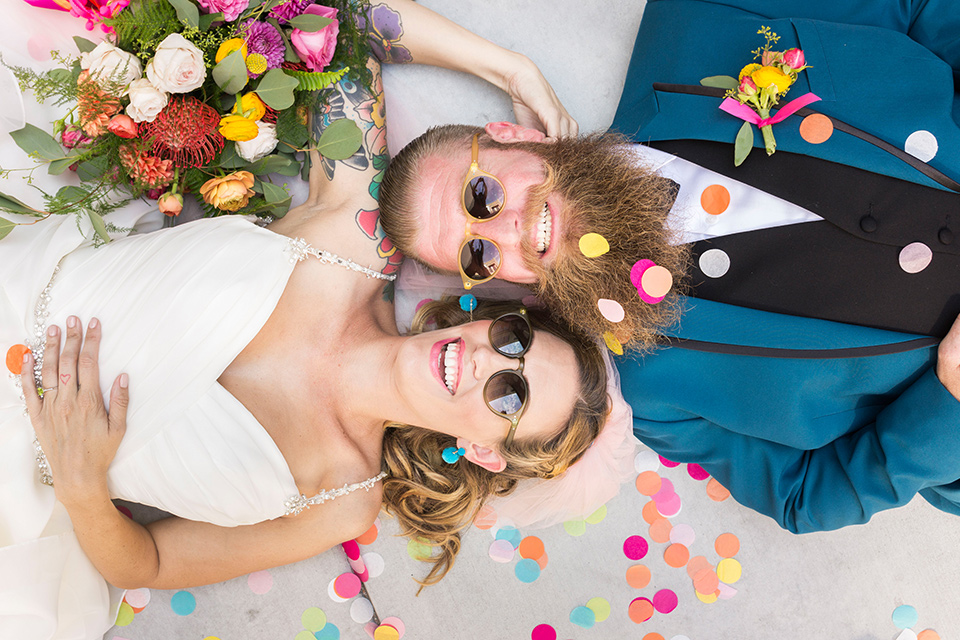 rock and roll bride and groom in las vegas with a teal tuxedo and sunglasses
