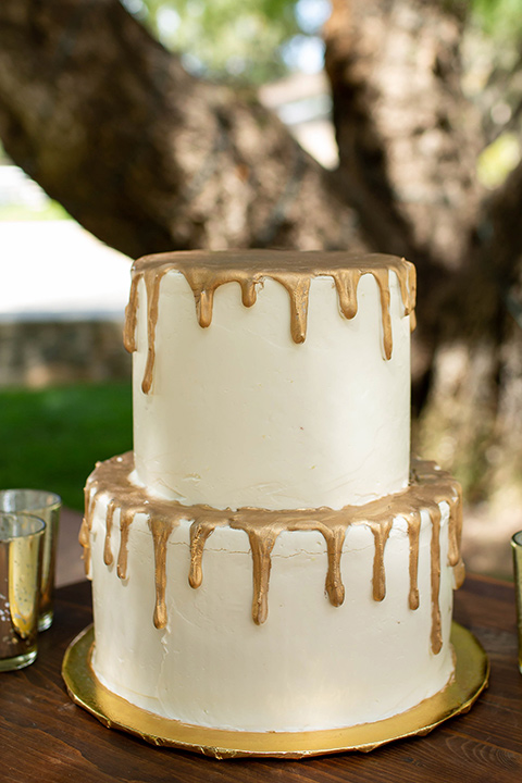 white cake with gold trim