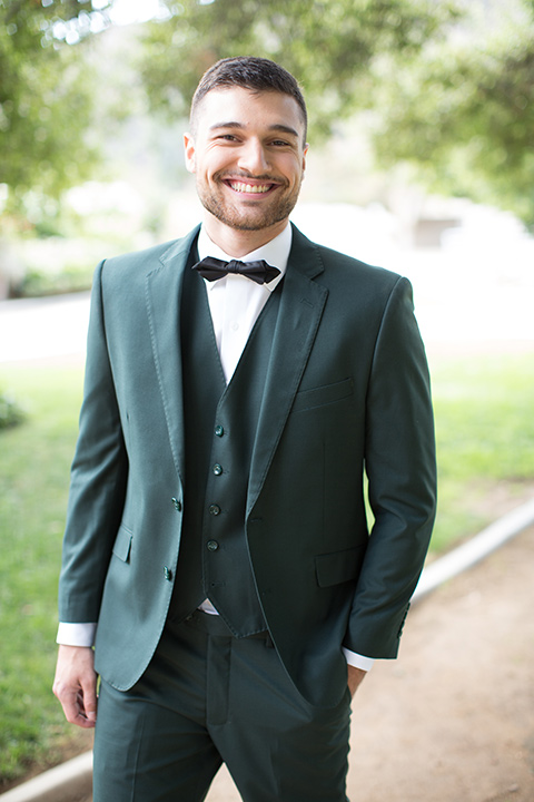 groom in a green suit