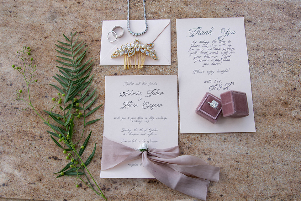 white invitations with a purple and pink design