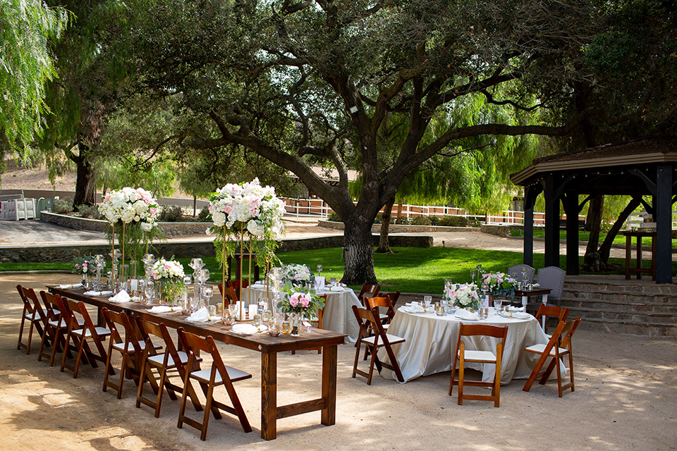 wooden tables and chairs with simple décor and white floral arrangements