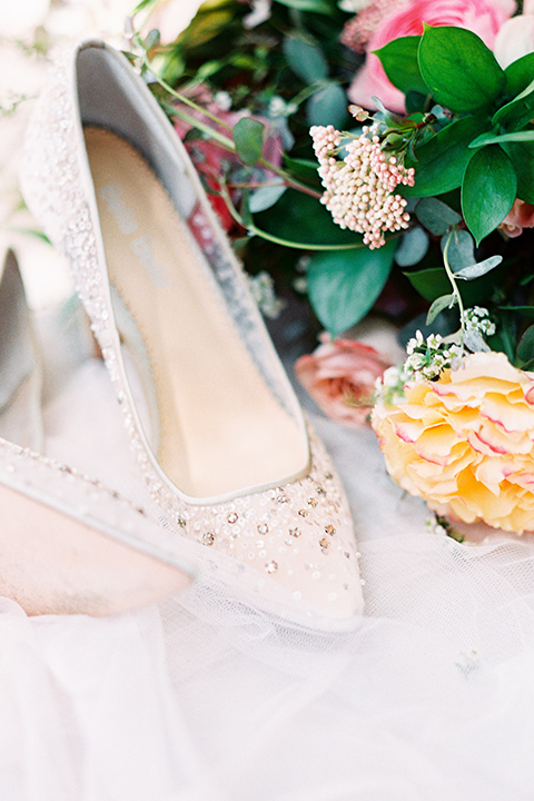 white bridal shoes with lace detailing and florals