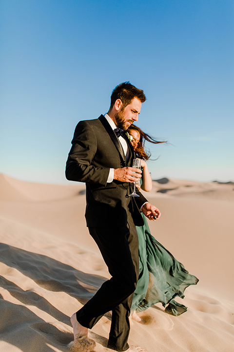 Glamis-Engagement-Shoot-bride-and-groom-walking-down-dunes-close-up