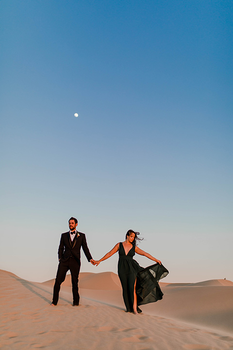 Glamis-Engagement-Shoot-bride-and-groom-with-moon-behind-them