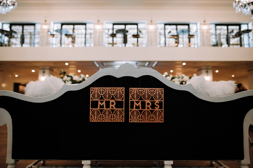 Art deco and roaring twenties inspired mr and mrs signs on the backs of the chairs