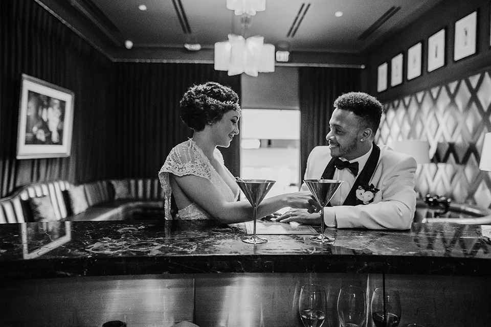 Art deco and roaring twenties inspired bride and groom at a bar