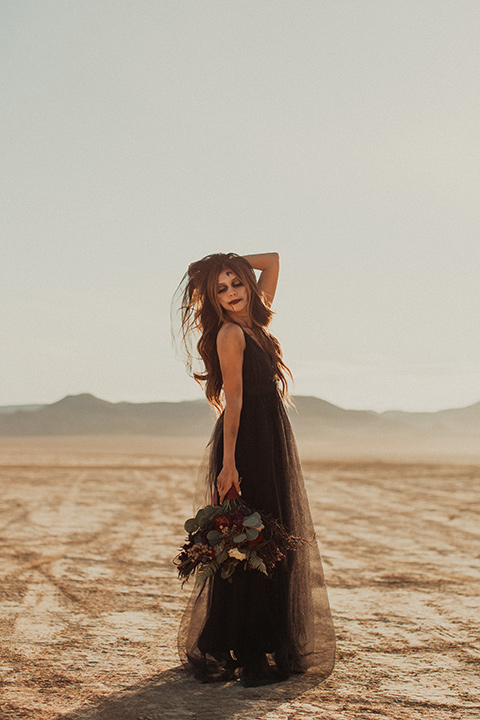 Halloween shoot with the bride in a burgundy and black tulle gown and a black veil