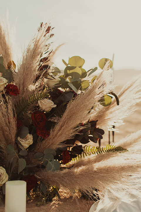 Halloween shoot with pampas grass and white and green florals