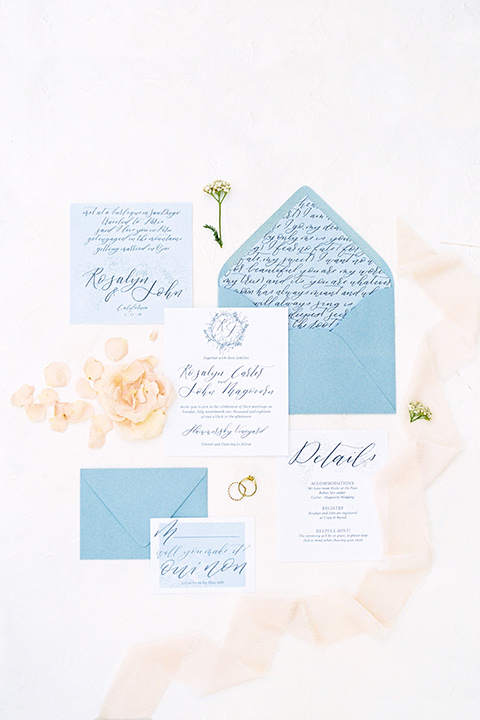 white and blue invitations with yellow flowers