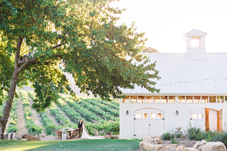 white barn venue with gardens and vineyards