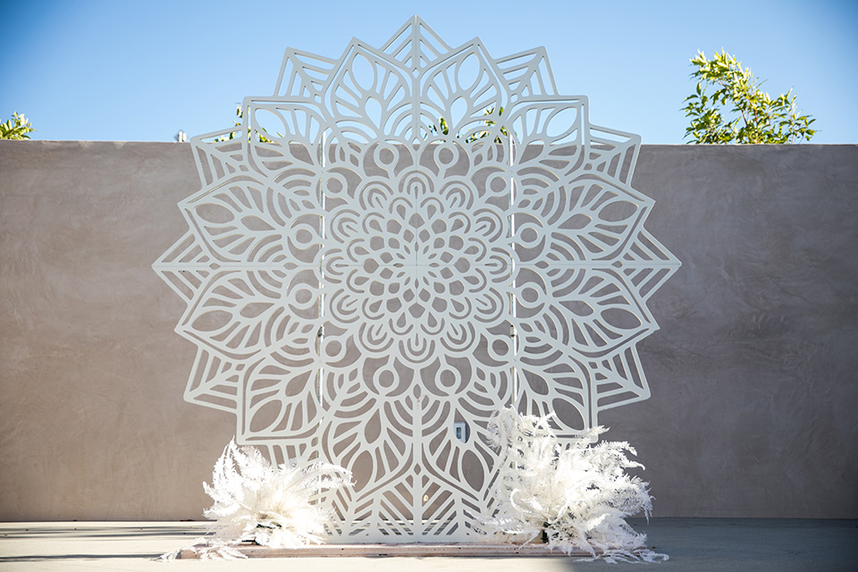 ceremony altar that looks like a lace or crocheted floral design