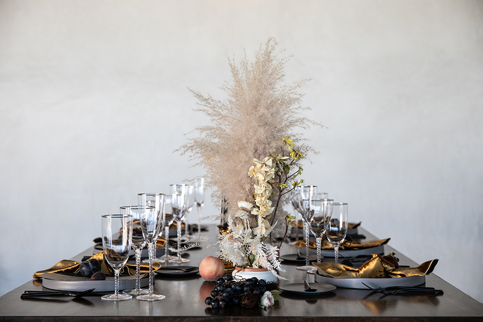 dark wooden table with feather centerpieces