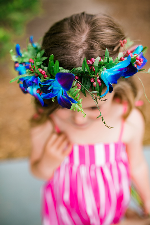 the flower girl in pink dress and flower headband