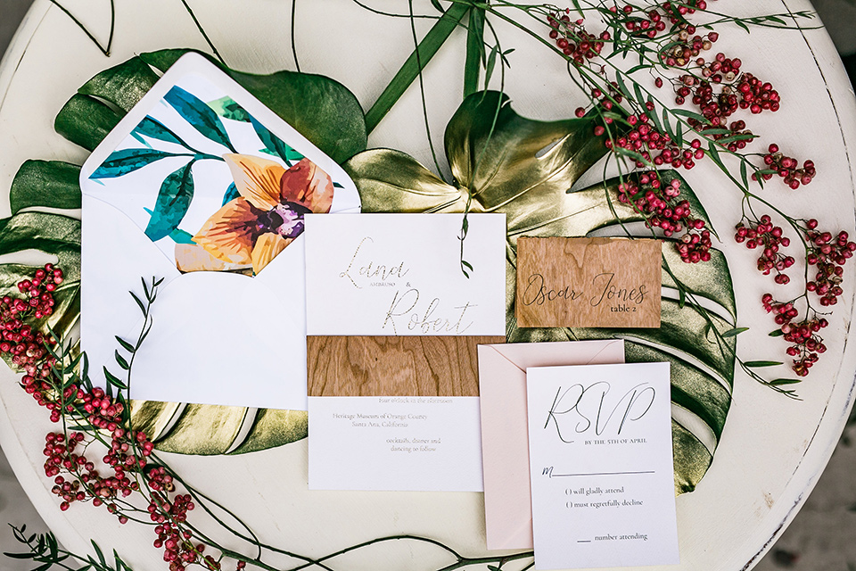 white invitations with tropical detailing