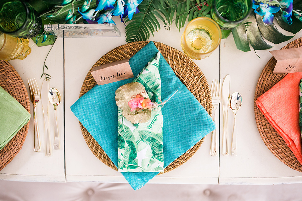 wooden table with bright colored napkins and flowers