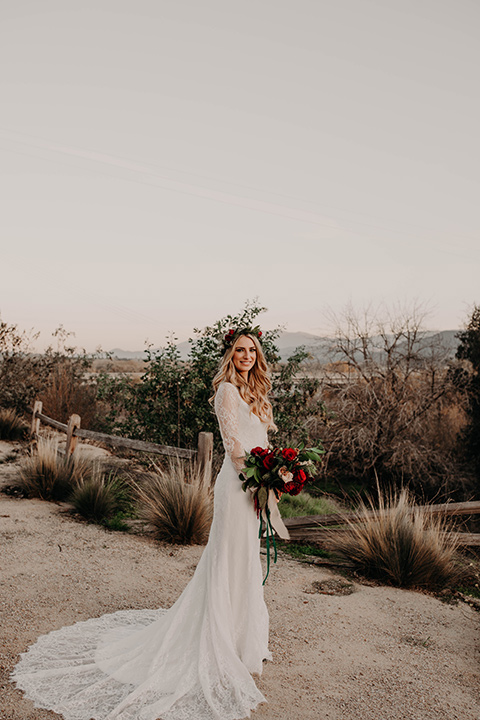 Highway-West-Vacations-bride-alone-in-a-lace-gown-with-sleeves-and-a-floral-crown