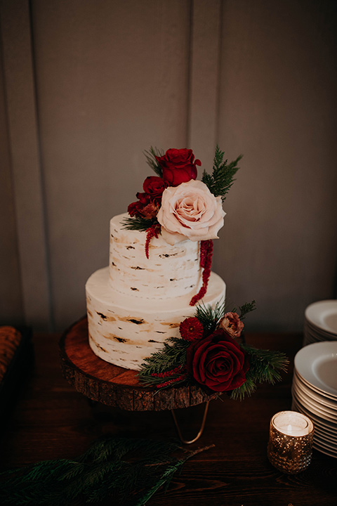 Highway-West-Vacations-cake-with-white-frosting-a-wooden-like-decor