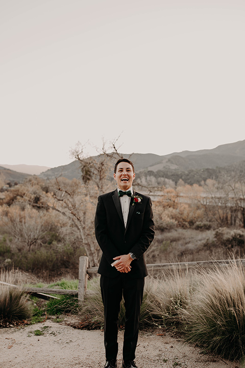 Highway-West-Vacations-groom-alone-in-a-black-tuxedo-with-a-velvet-bow-tie