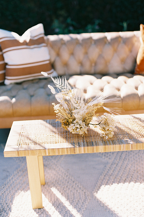 tan couch with bohemian decor