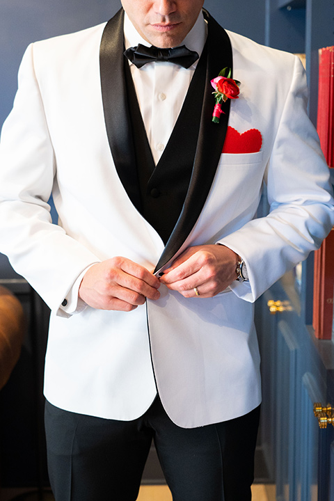 I-love-lucy-shoot-close-up-on-groom-in-a-white-and-black-tuxedo