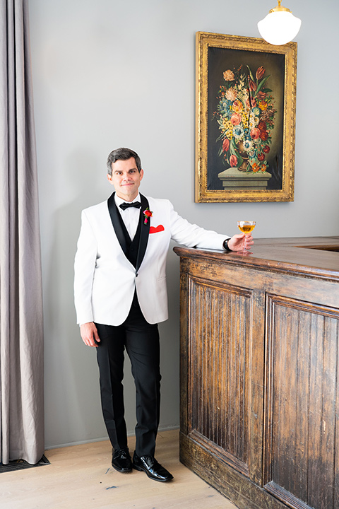 I-love-lucy-shoot-groom-standing-at-bar-in-a-white-and-black-tuxedo