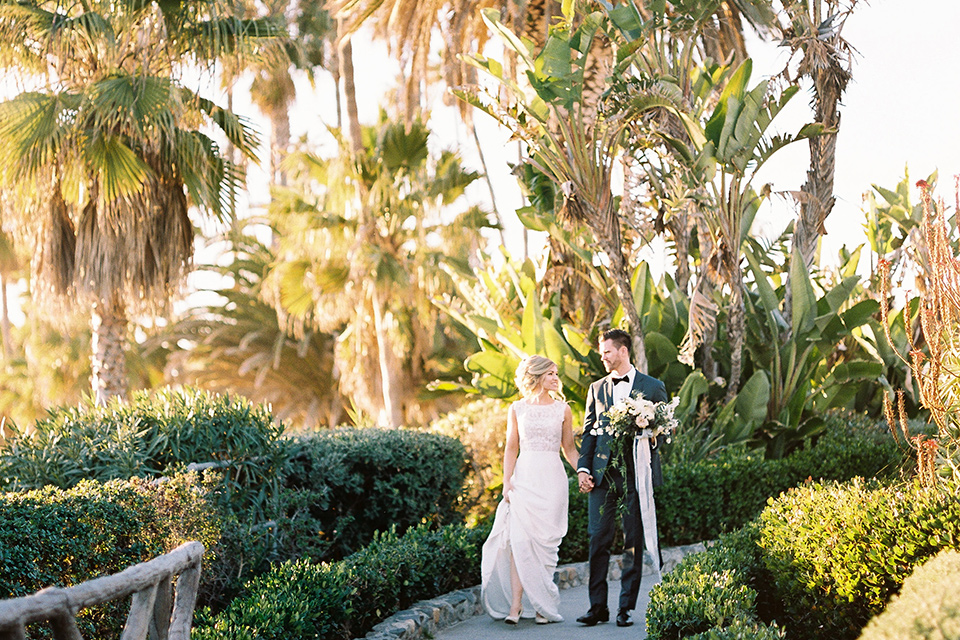 The-Inn-at-Laguna-Beach-bride-and-groom-walking-on-the-grounds-on-the-venue