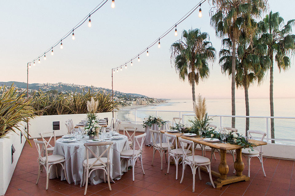 The-Inn-at-Laguna-Beach-reception-with-wooden-tables-and-chairs-with-string-lights
