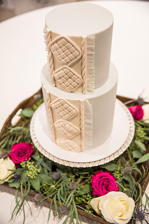 Intercontinental-elopement-shoot-cake-all-white-with-intricate-white-macrame-design