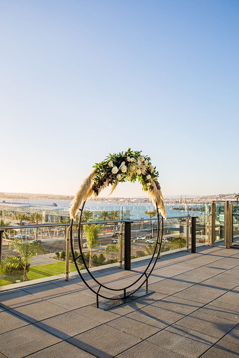 Intercontinental-elopement-shoot-ceremony-arch-in-a-circle-design-with-flowers