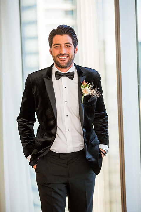 Intercontinental-elopement-shoot-groom-in-black-velvet-looking-at-camera