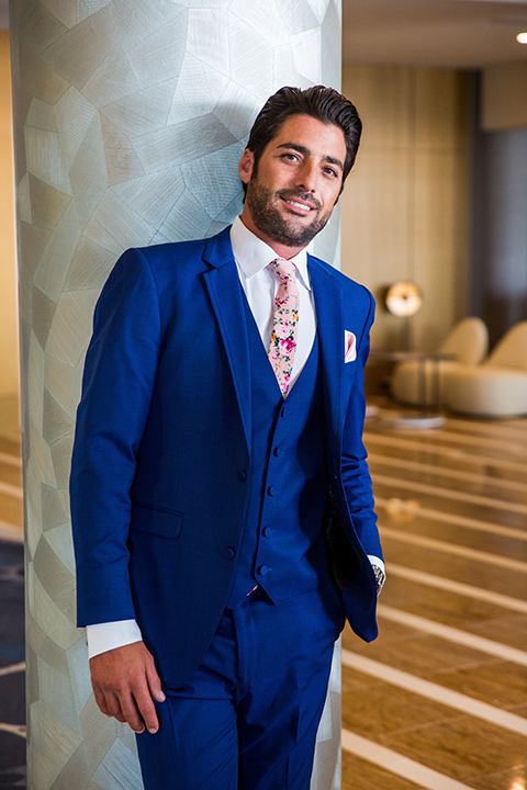 Intercontinental-elopement-shoot-groom-in-a-cobalt-blue-suit-with-pink-floral-tie