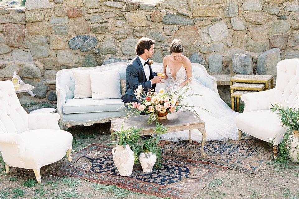 italian-style-wedding-bride-and-groom-sitting-on-couch