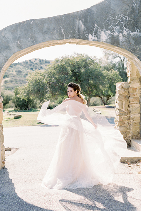 italian-style-wedding-bride-twirling-in-a-flowing-gown-with-straps