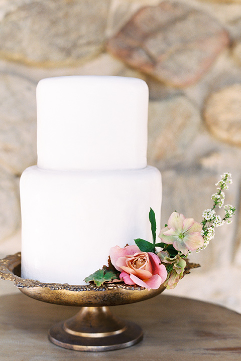 italian-style-wedding-cake-with-white-fondant-and-simple-flowers