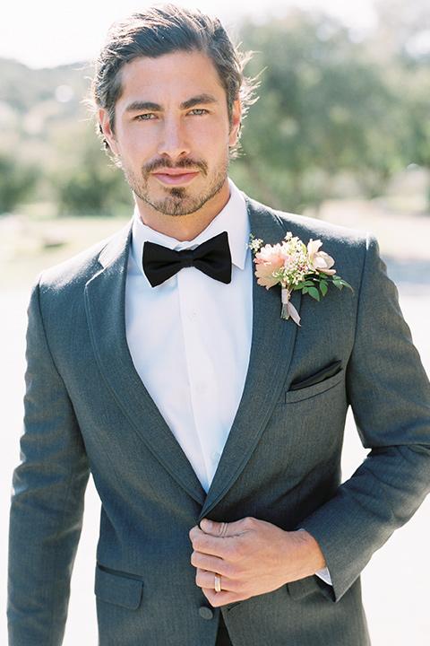italian-style-wedding-groom-looking-at-camera-in-a-grey-tuxedo